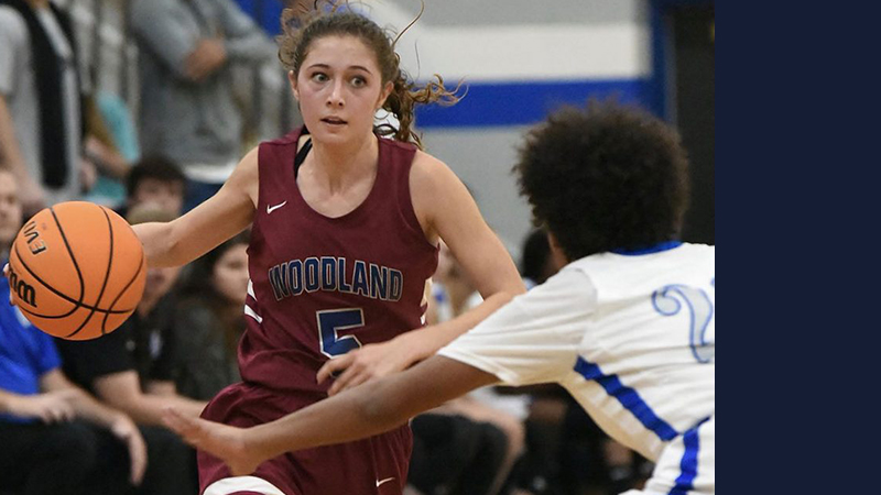 Woodland girls set season-best marks in points, margin of victory