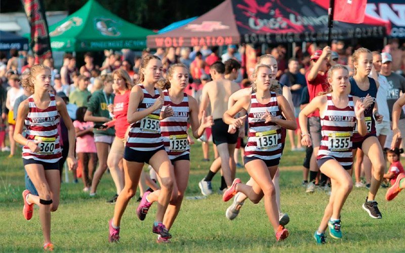 Woodland girls edge XC rivals at Dellinger