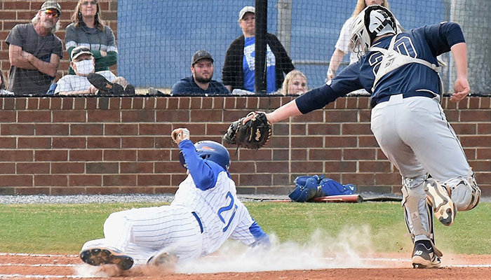 Read more about the article Cass sweeps Woodland, takes early lead in playoff chase